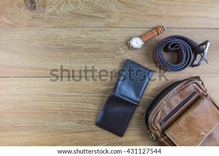 Leather for men on wooden background./ Flat lay leather for men. - stock photo