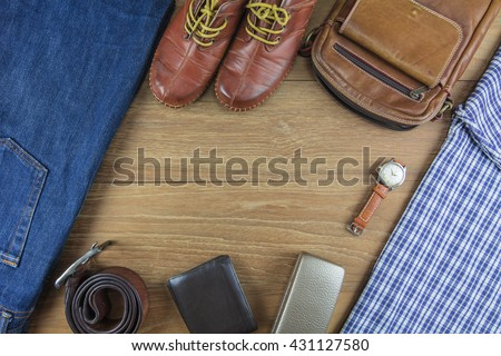 Leather for men on wooden background./ Flat lay leather for men./ Leather and jeans for men. - stock photo