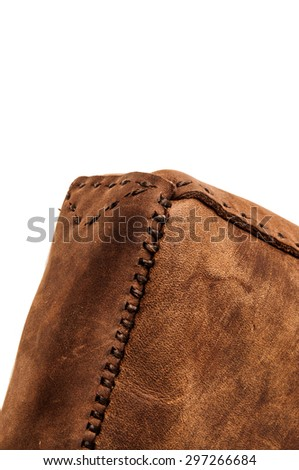 Leather Handmade Stitch, Making of Bag Design (Brown Tan). Handcrafted Leather, Hand Sewing and Stitching. Rustic Style. Isolated on White Background. Vertical. - stock photo