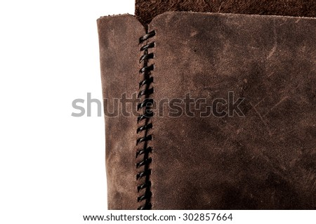 Leather Handmade Stitch, Making of Bag Design (Dark Brown). Handcrafted Leather, Hand Sewing and Stitching. Rustic Style. Isolated on White Background. - stock photo