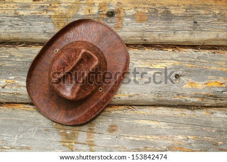 Leather hat hanging wall of a village house. Texture, background