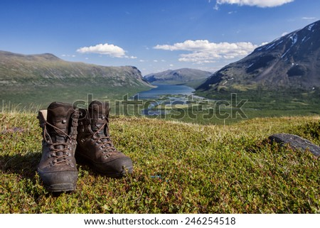 leather hiking boots over the mountains in Sweden - stock photo