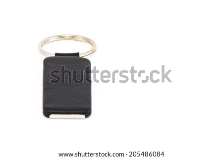 Leather key chain on white background - stock photo