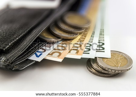 Leather men's open wallet with euro banknotes bills, coins and credit card inside isolated on white background.