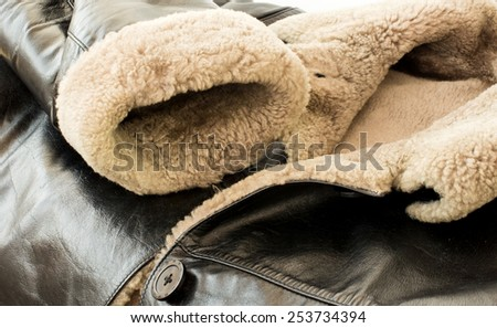 Leather natural sheepskin coat of black color with fur - stock photo