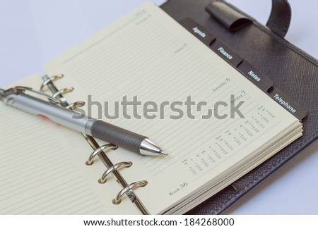 Leather notebook and pen - stock photo