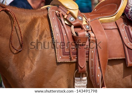Leather saddle closeup details - stock photo