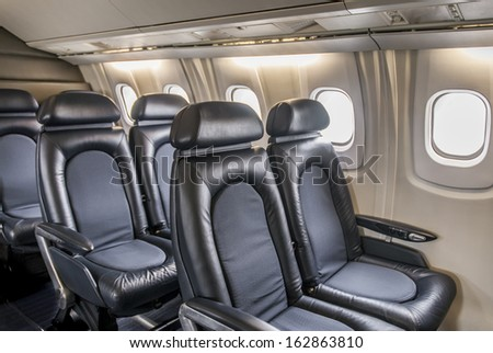 Leather seating inside cabin of a luxury jet Concorde. - stock photo