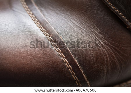 Leather shoes, focus on details. Macro shot with shallow depth of field - stock photo