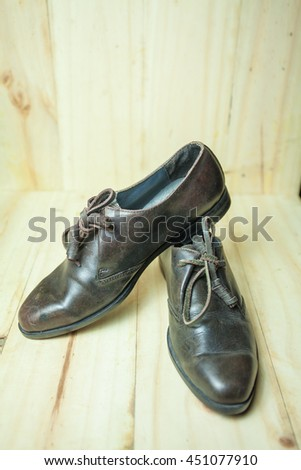 Leather shoes, men's fashion wooden background.