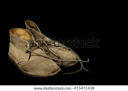 Leather shoes on a black background.