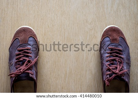 Leather shoes on the wooden floor