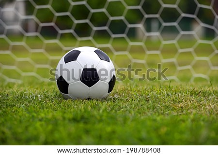 Leather soccer ball on a football stadium - stock photo