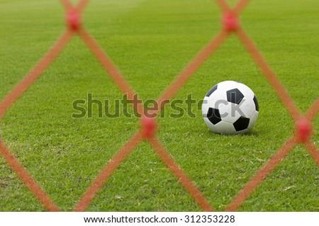 Leather soccer ball on a football stadium - stock photo