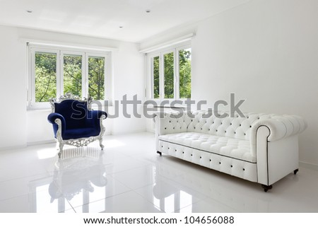 leather sofa, armchair classical, in white room - stock photo