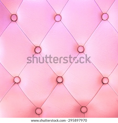 leather sofa color pink background - stock photo