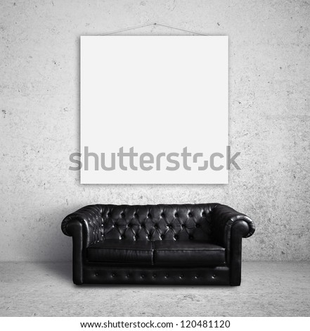 leather sofa in concrete room - stock photo