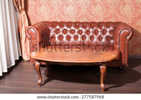 Leather sofa in vintage style luxury interior - stock photo