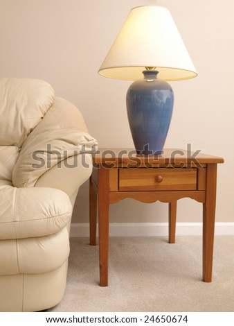 Leather Sofa with Lamp on full End Table - stock photo
