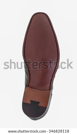 Leather soles of a man shoe on a white background