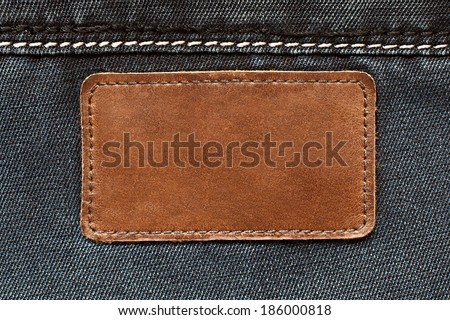 Leather tag on jeans background - stock photo