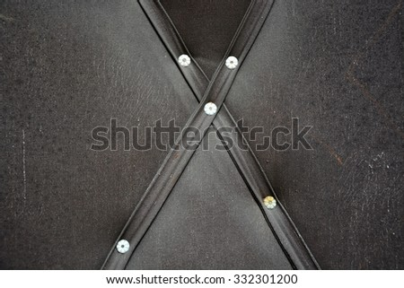 Leather texture with rivets - stock photo