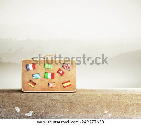 leather  travel bag with many flags, close up - stock photo