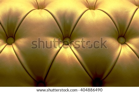 Leather upholstery of a magnificent sofa - stock photo