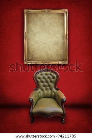 leather vintage chair and gold frame in red room