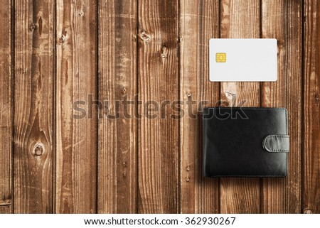 Leather wallet and credit card mock-up on wooden table