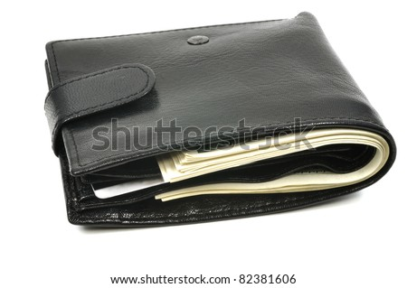 Leather wallet full of dollars, isolated on white - stock photo