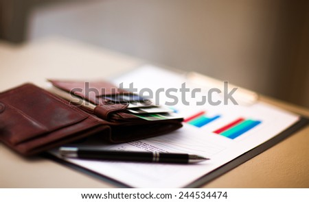 leather wallet with credit and discount cards - stock photo