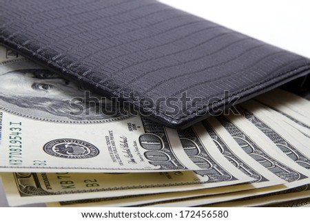 Leather wallet with money, a close up, selective focus - stock photo
