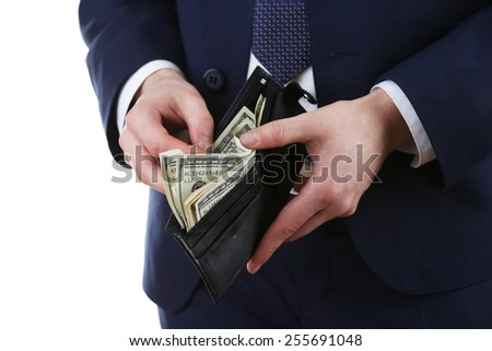 Leather wallet with money in male hands isolated on white background - stock photo
