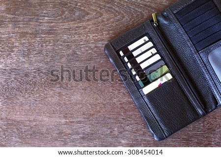 Leather wallet with multiple credit cards on the wooden table  - stock photo