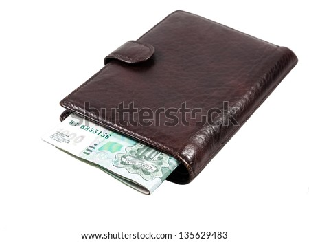 Leather wallet with one thousand russian rubles isolated on white background.