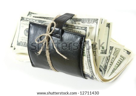 Leather wallet with some dollars inside on white background - stock photo