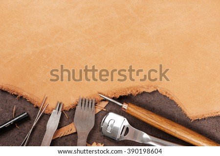 leather working background, blank tan nubuck leather in workshop - stock photo