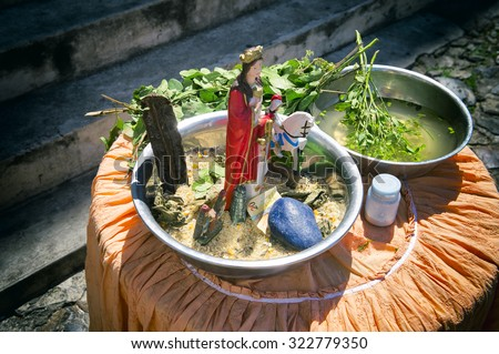 Leaves infused with sacred water wait on a table for use in candomble axé blessings in the tourist center of Pelourinho, Salvador, Bahia, Brazil - stock photo