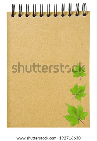 leaves on ring binder brown book or recycled paper notebook isolated on white background, clipping path - stock photo