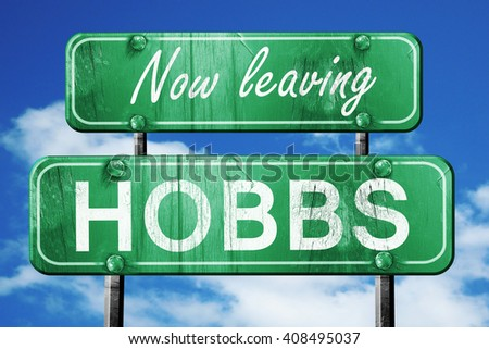 Leaving hobbs, green vintage road sign with rough lettering