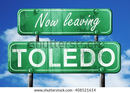 Leaving toledo, green vintage road sign with rough lettering