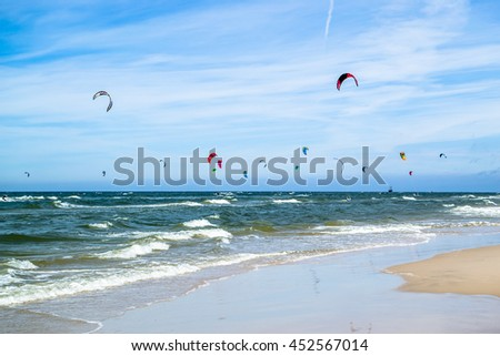 LEBA, POLAND - JULY 09, 2016: Kite surfing on the beach in Poland. Polish sea coast is popular place for extreme water sport like kitesurfing.