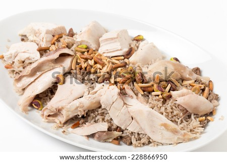 Lebanese chicken with spiced rice seen at an angle, this is a traditional dish for celebrations - stock photo