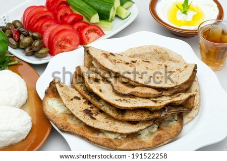 Lebanese food of Cheese and thyme manouche with veggies isolated  - stock photo