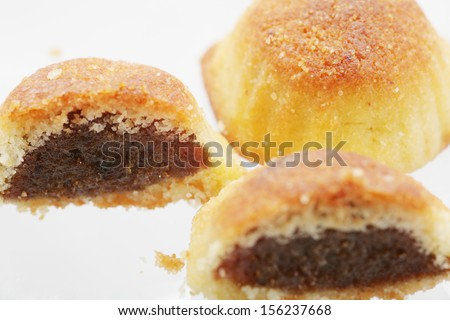 Lebanese Maamoul bi Tamer dessert. Lebanese Typical Easter cookie.  Focus in the left cookie. - stock photo