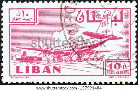 LEBANON - CIRCA 1959: A stamp printed in Lebanon shows Douglas DC-6B at Khalde airport, circa 1959.  - stock photo