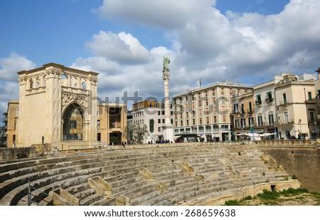 LECCE, ITALY - MARCH 13, 2015: Roman Amphiteatre (2nd Century) at the Sant Oronzo square in Lecce, Apulia, Italy - stock photo