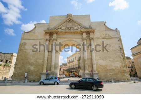 LECCE, ITALY - MARCH 13, 2015: The triumphal arch, commonly known as Neapolitan Gate or Porta Napoli in Lecce, Apulia, Southern Italy, was erected in 1548 in honor of Charles V. - stock photo