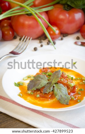 lecho stewed vegetable salad pepper tomato carrot on a white plate with vegetables